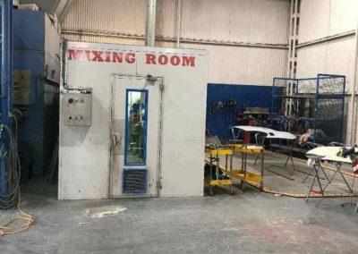 The mixing room is a sealed unit which allows for auto body paint to be prepared in a non-contaminated environment