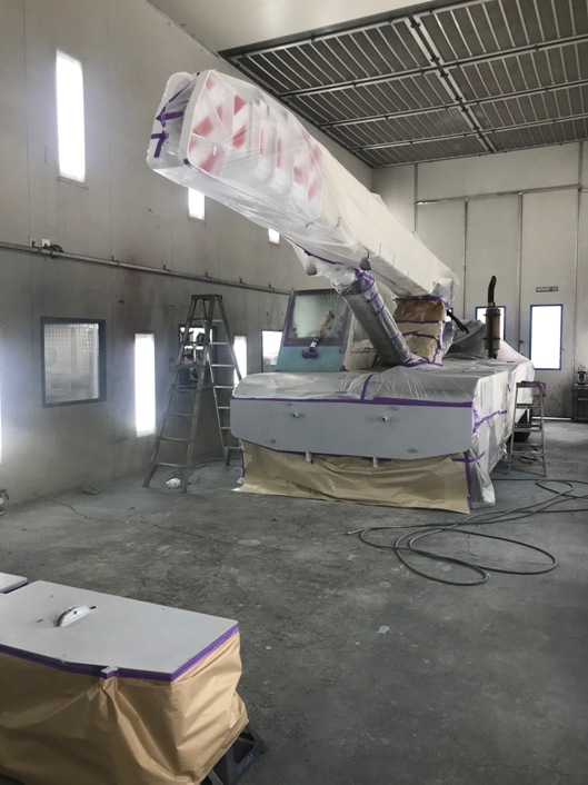 This large crane and its boom were damaged in a crash and both had to be rebuilt. Here it is about to be resprayed  and a section has  been removed to make it easier to respray the crane and this forward section