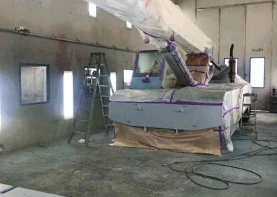This photo of a boom crane demonstrates just how big this one of three Simpson Crash spray painting booth is in both height and depth